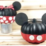 Mickey Mouse decorated pumpkin with Minnie Mouse pumpkin in background