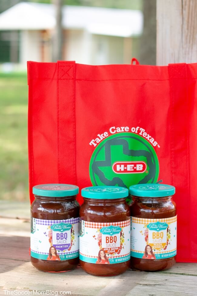 3 jars of Pioneer Woman BBQ sauce in front of a red, reusable H-E-B bag