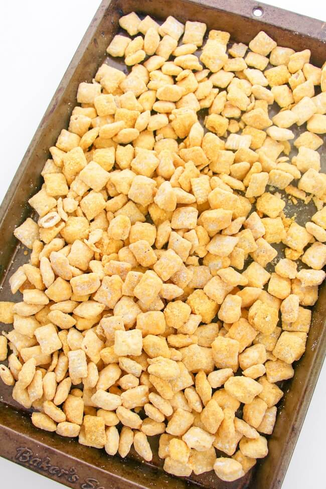 candy coated Chex cereal on baking sheet