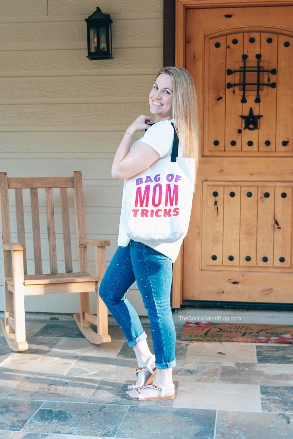 mom holding tote bag