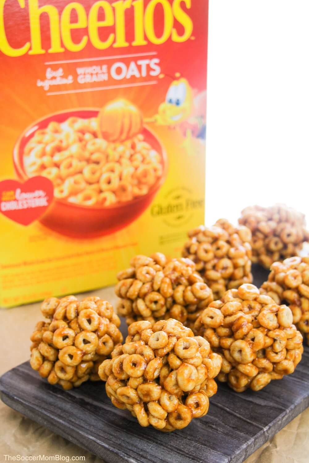 Cheerio balls with Cheerios box in background