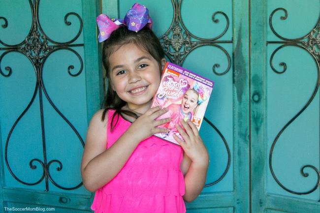 little girl posing with Jojo Siwa DVD