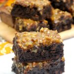 These decadent Pecan Pie Brownies are so fudgy and delicious! The pecan pie filling on top makes this a truly amazing dessert!