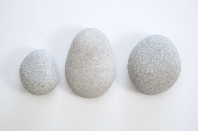 three smooth river stones used for painting