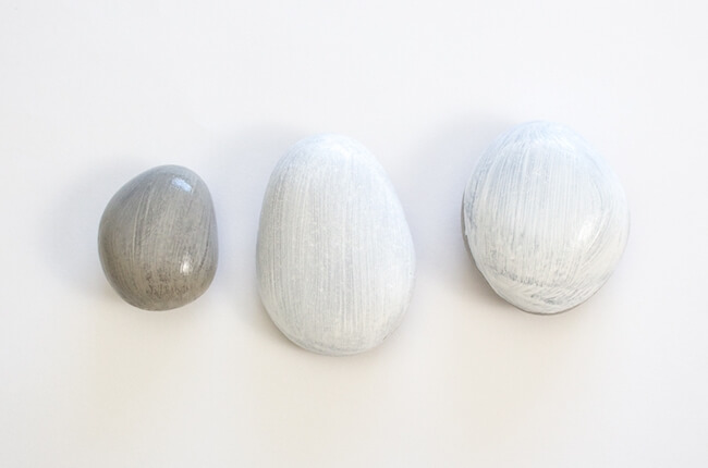 three rocks painted white and gray