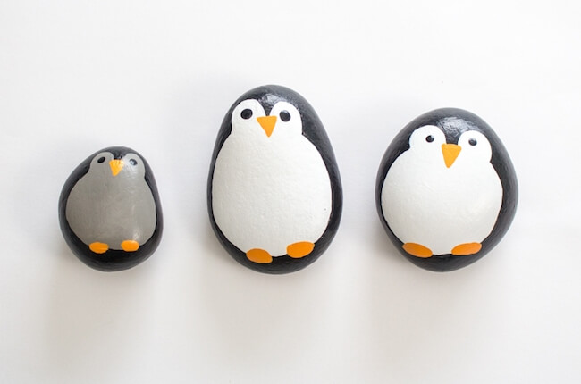 three rocks painted to look like penguins