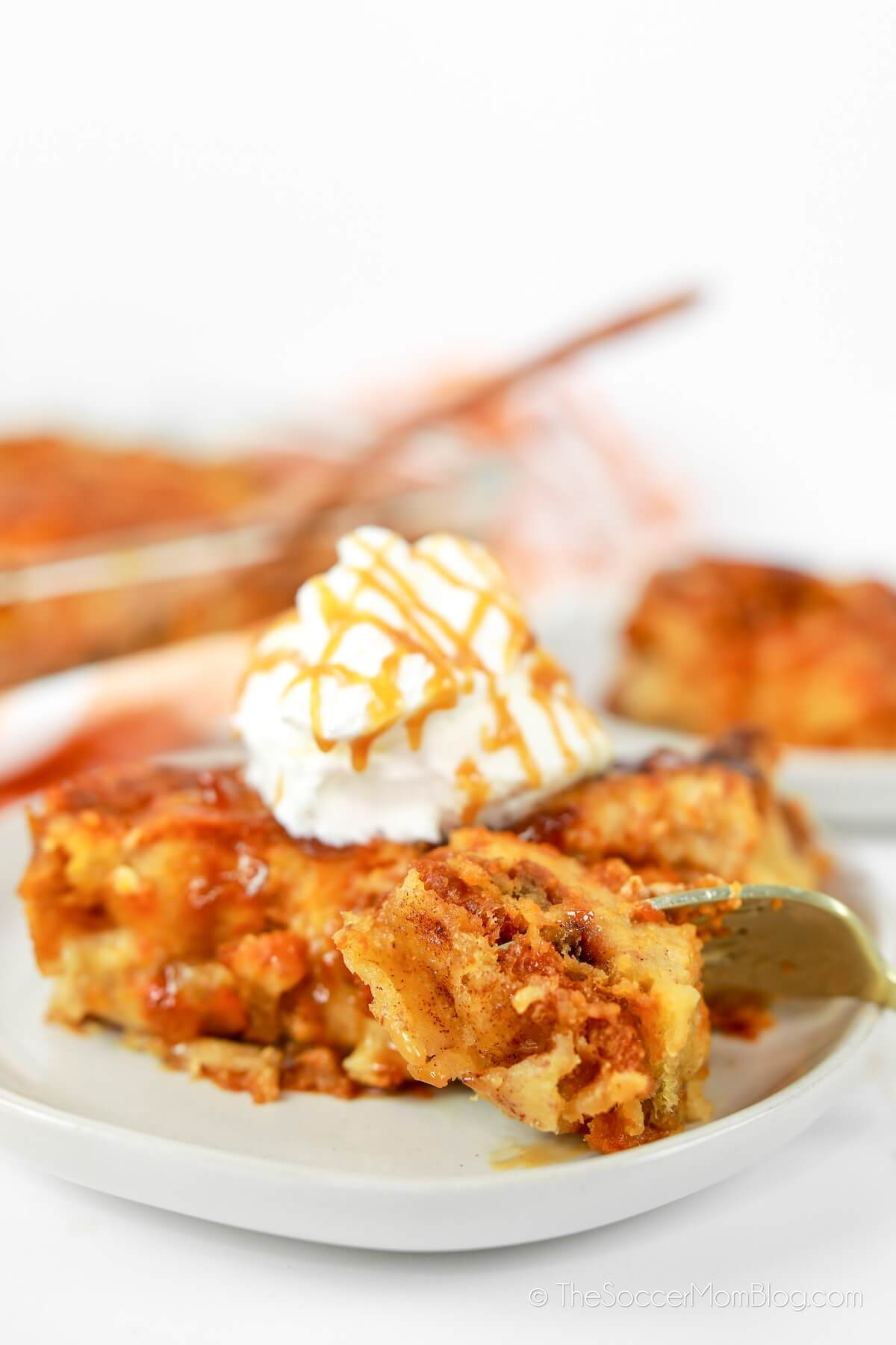 cutting into a slice of pumpkin bread pudding
