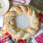 A festive holiday appetizer that's bursting with warm cheesy goodness, this Cheesy Pull Apart Bread Wreath will be the hit of every Christmas party! Sponsored by Borden® Cheese.