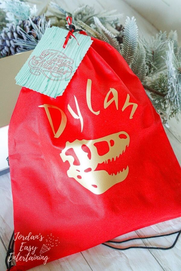 red and gold gift bag made with the Cricut