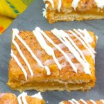 close up of a pumpkin cheesecake bar with churro topping
