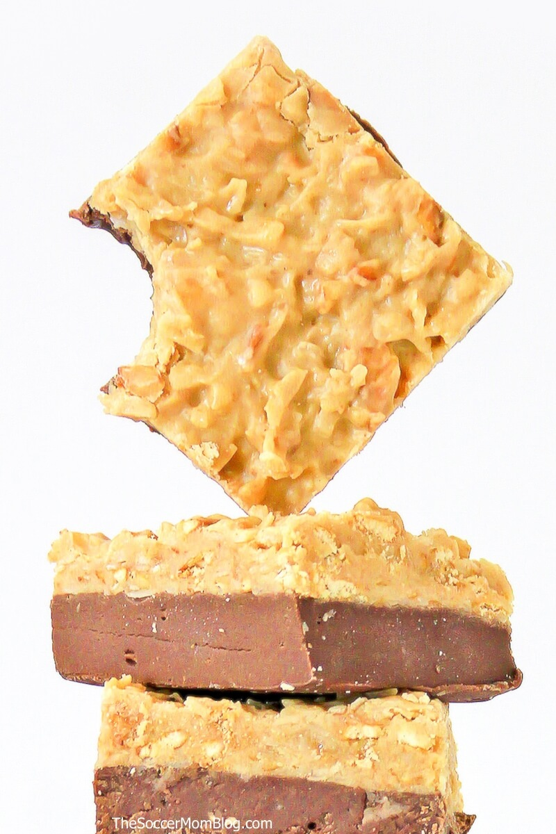 Close up of a square of German chocolate fudge with a bite missing