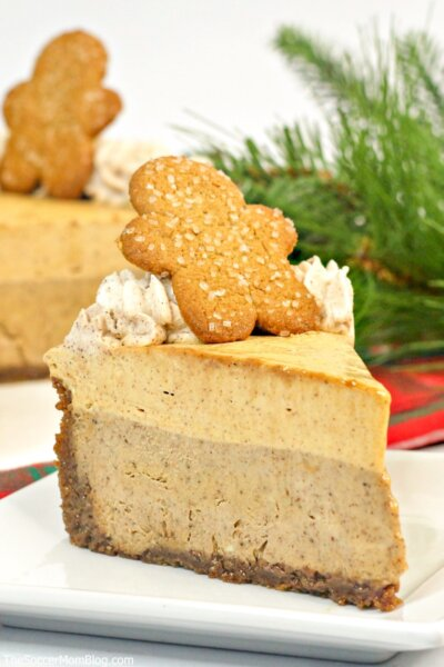 This fun and festive Gingerbread Cheesecake features smooth cheesecake, flavorful gingerbread mousse, and homemade cinnamon whipped cream. It's a decadent and delightful holiday treat that looks amazing on the Christmas party table!