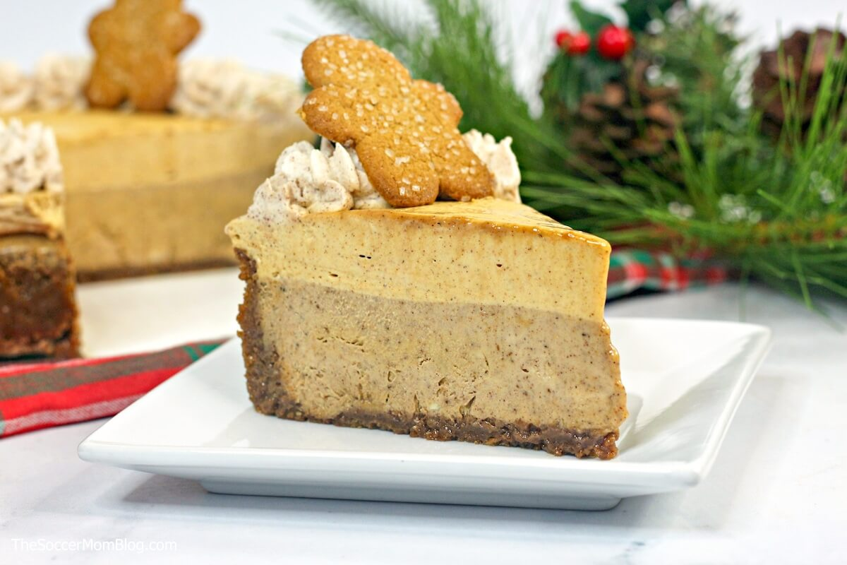 slice of gingerbread cheesecake with full cake in background