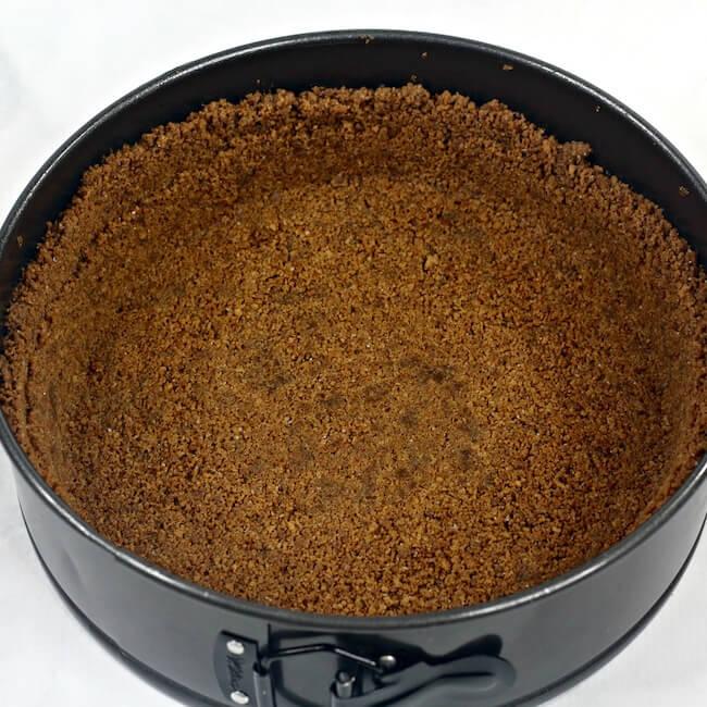 baking homemade gingersnap crust in springform pan