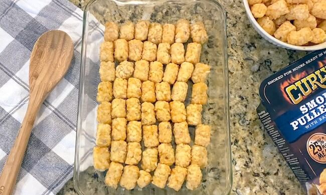 layering tater tots in casserole dish
