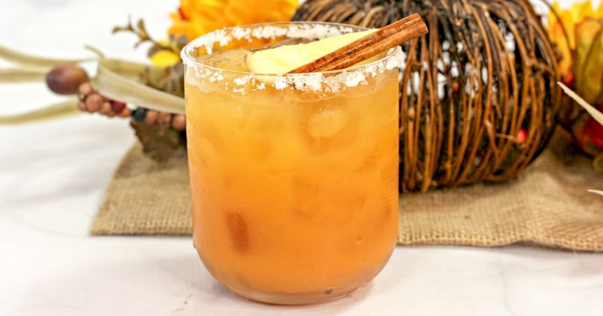 A smooth, sweet, and spicy fall themed cocktail, this Thanksgiving Margarita is a treat for the taste buds! One of the most unique margarita recipes you'll ever try!