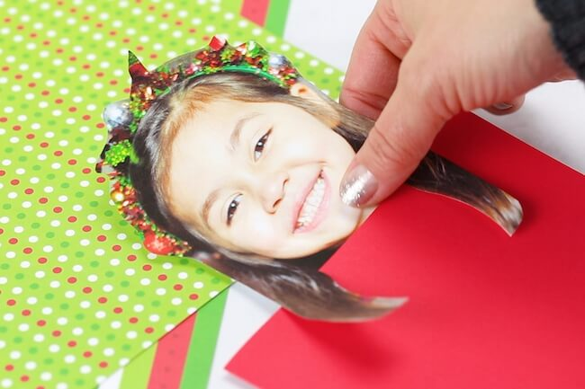 gluing child's photo to Christmas card