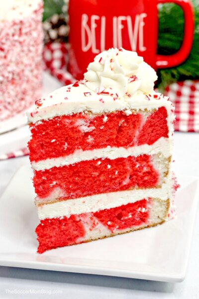slice of red and white peppermint layer cake