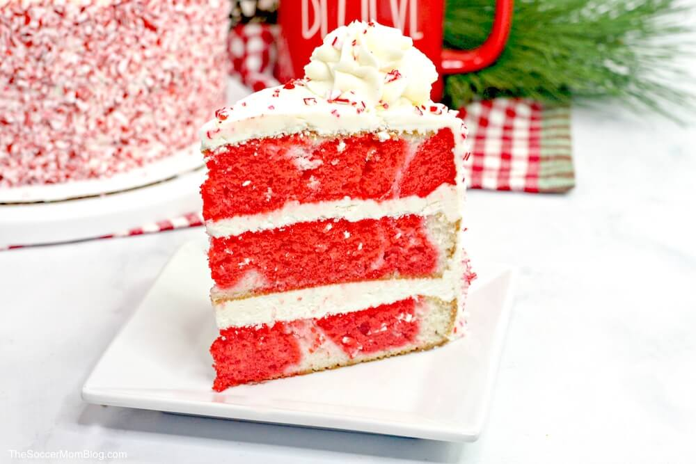 Candy Cane Cake: A classic white cake infused with cool peppermint, topped with creamy peppermint buttercream frosting and crushed candy canes.