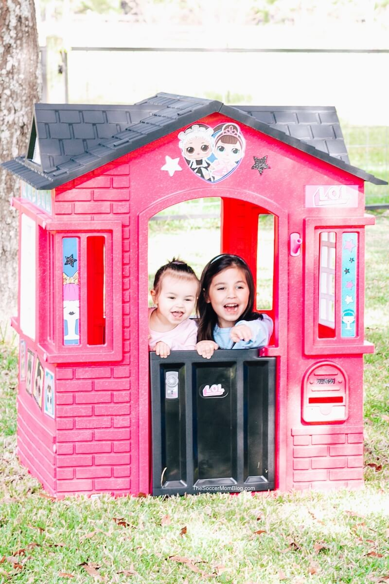 little girls playing in Little Tikes playhouse