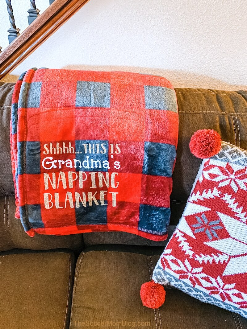 Personalized blankets make a great gift idea, but they can be quite pricey to purchase! We'll show you how to make your own DIY nap blanket and how to use heat transfer vinyl on fleece blankets with an easy step-by-step guide.