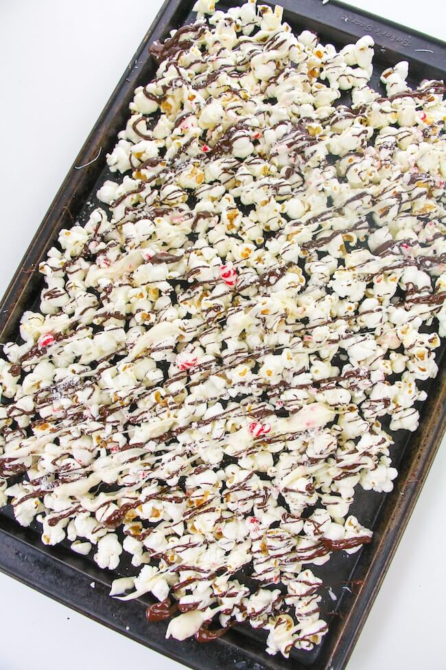 cookie sheet with peppermint bark popcorn