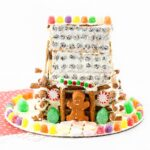 Like a gingerbread house, only better! This candy covered pretzel log cabin is easy for kids to make and delicious to eat!
