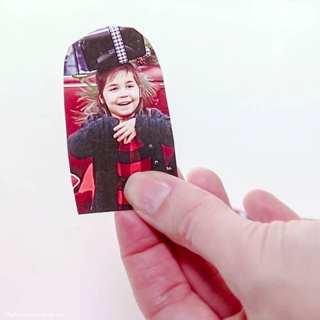 child's photo cutout to make snow globes