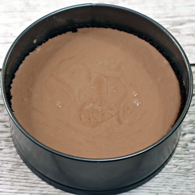 chocolate cheesecake batter in spring form pan