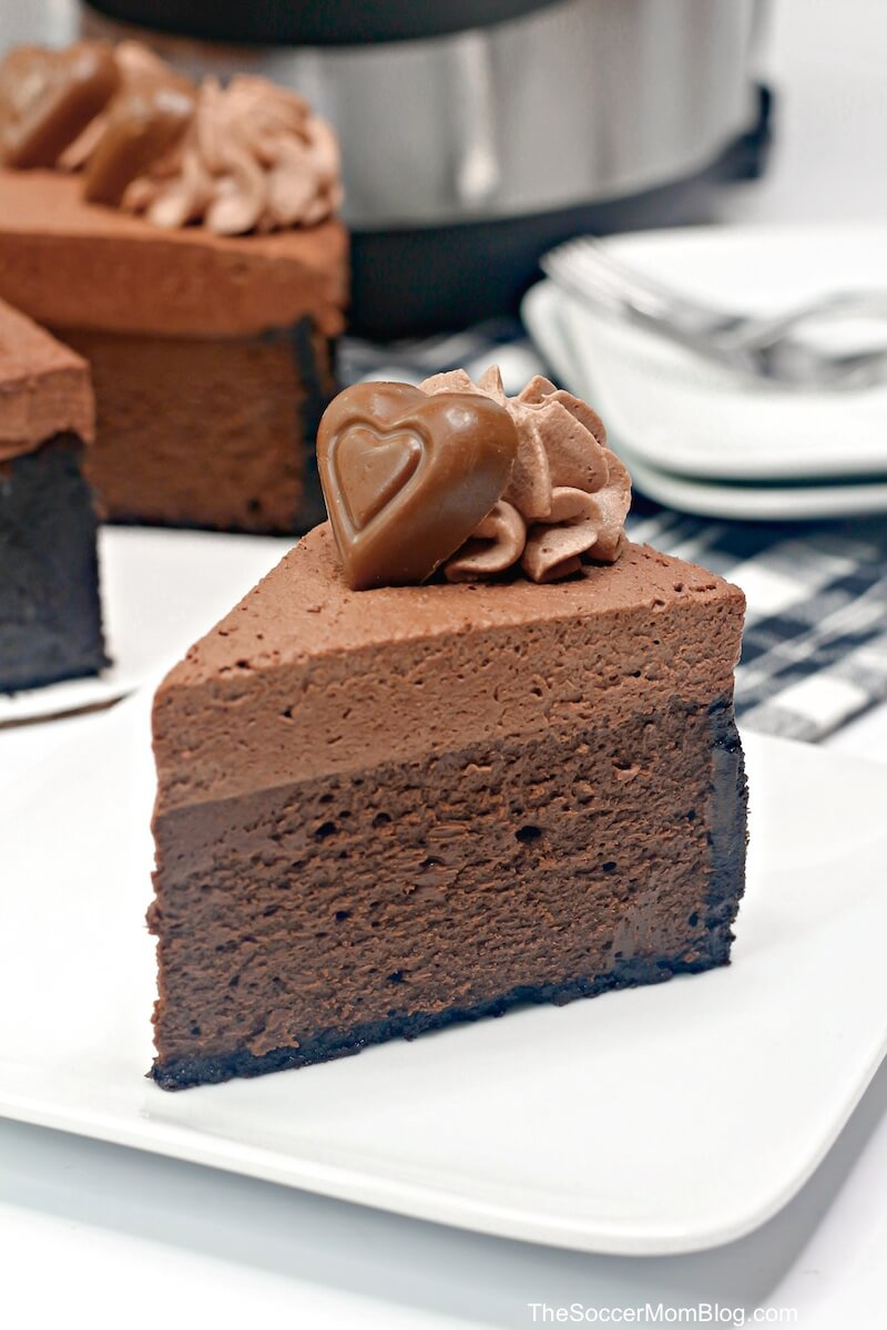 slice of Instant Pot chocolate cheesecake with Godiva chocolate on top