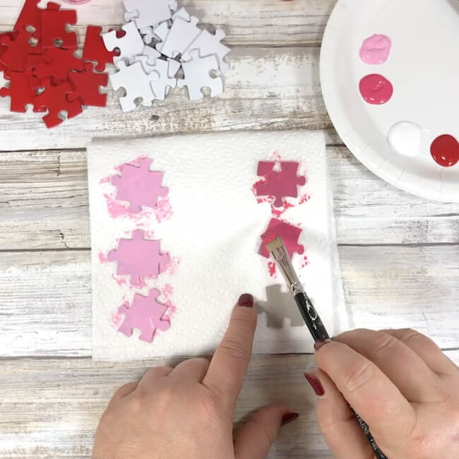 painting puzzle pieces red and pink