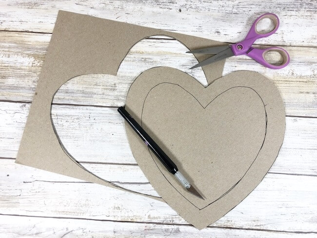 cutting heart out of cardboard