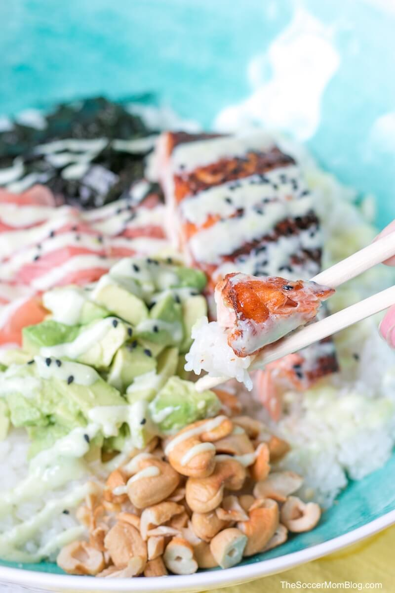 Japanese salmon sushi rice bowl with chopsticks