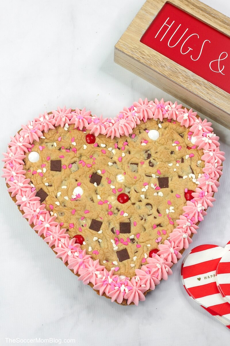 Valentine cookie cake with pink frosting and sprinkles