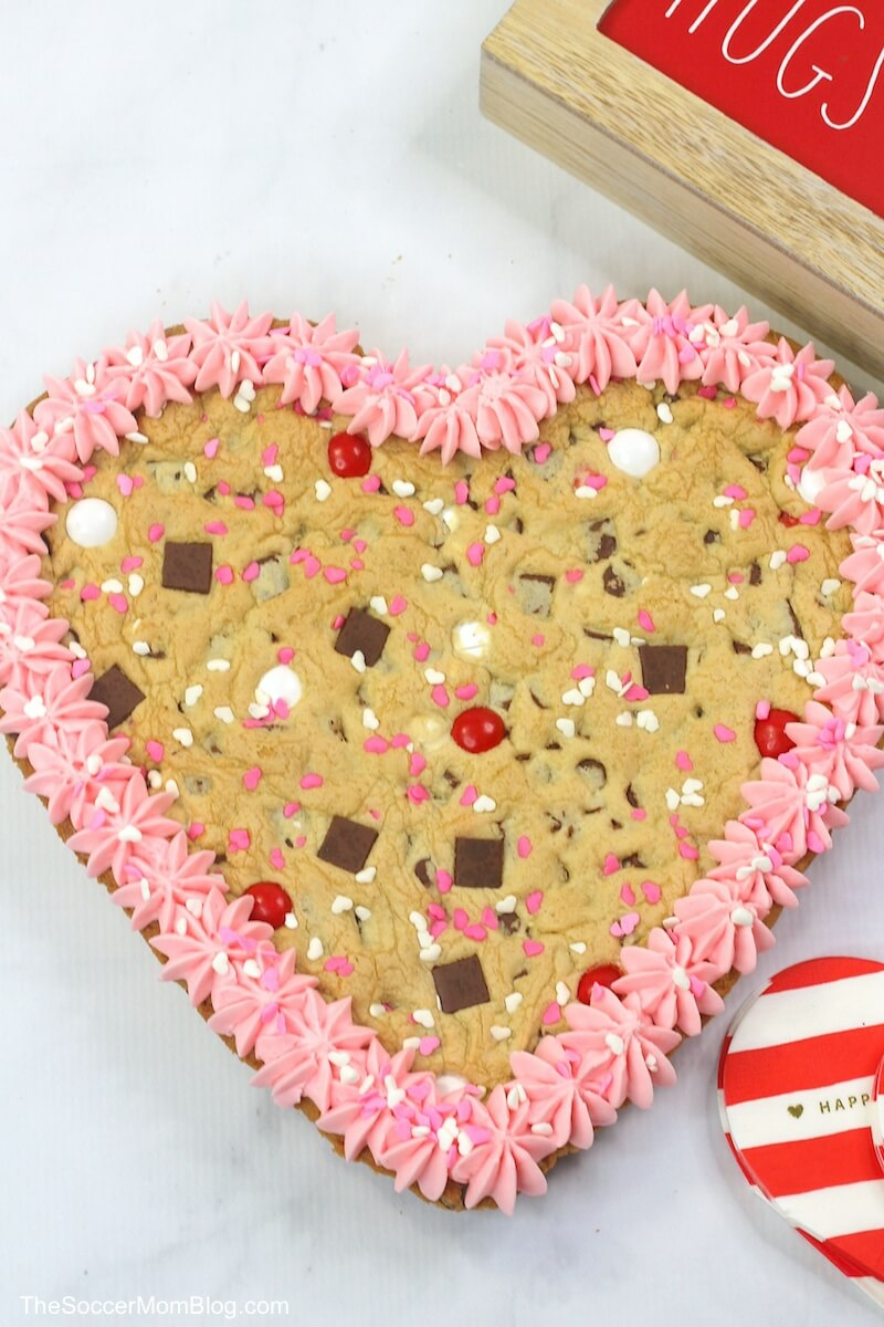 heart shaped chocolate chip cookie cake with pink frosting