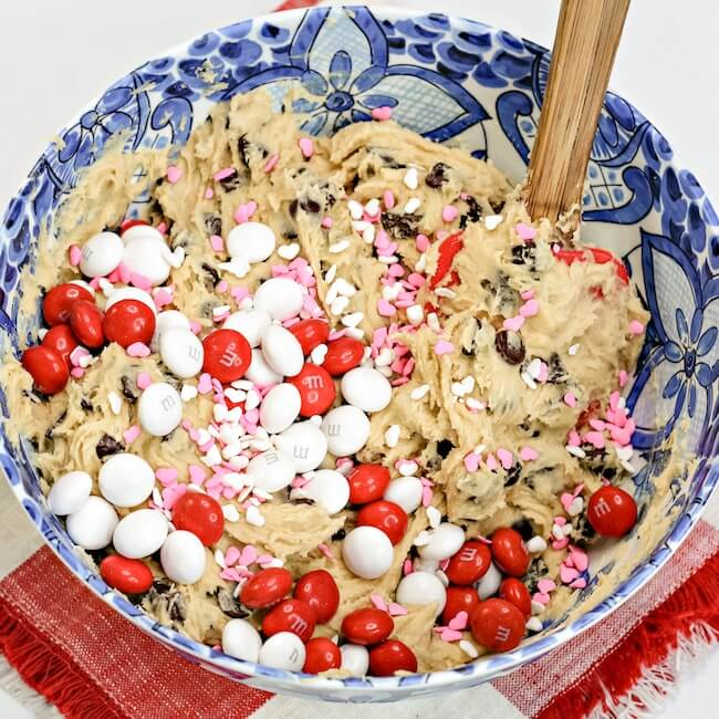 chocolate chip cookie dough batter with Valentine candy in bowl