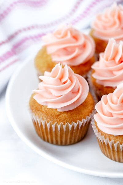 plate of pink champagne cupcakes with frosting