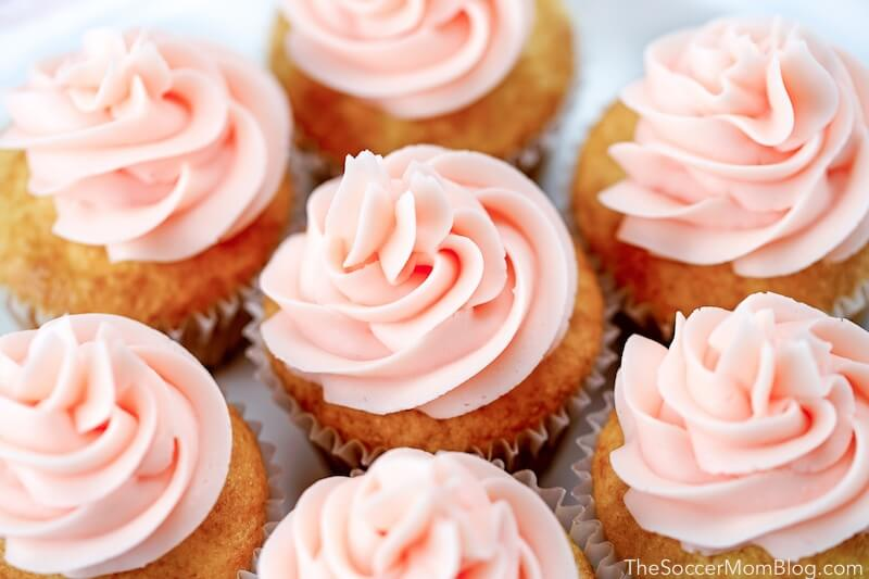 top-down shot of champagne cupcakes with swirled pink frosting