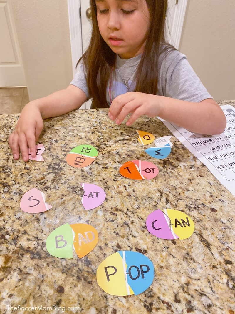 playing a sight words game with Easter egg shaped matching cards