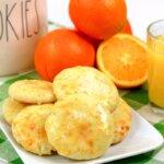 orange cookies with oranges and orange juice