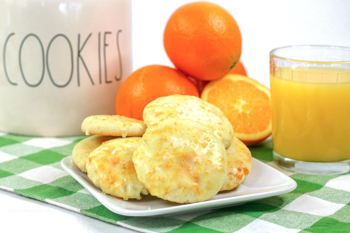 orange cookies with oranges and orange juice