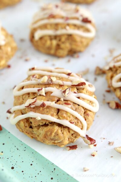 Carrot cake flavored cookies topped with frosting and chopped pecans