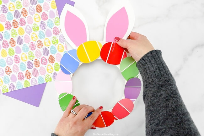 attaching paper bunny ears to Easter wreath