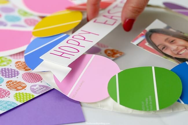 attaching paper banner to Easter bunny wreath