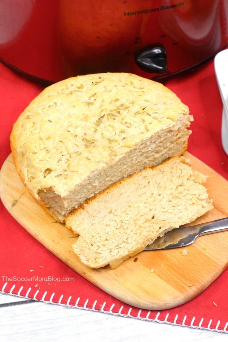 loaf of fresh baked crockpot bread on cutting board