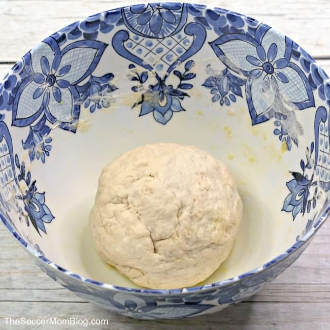 bread dough in ceramic bowl