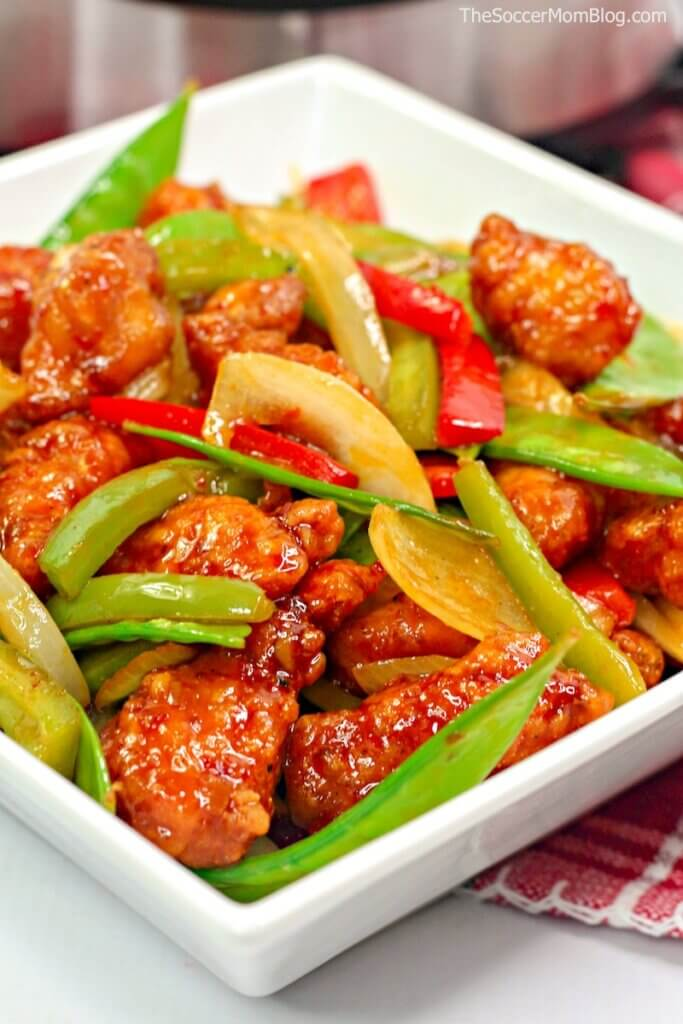 Crispy Firecracker Chicken with peppers and snow peas
