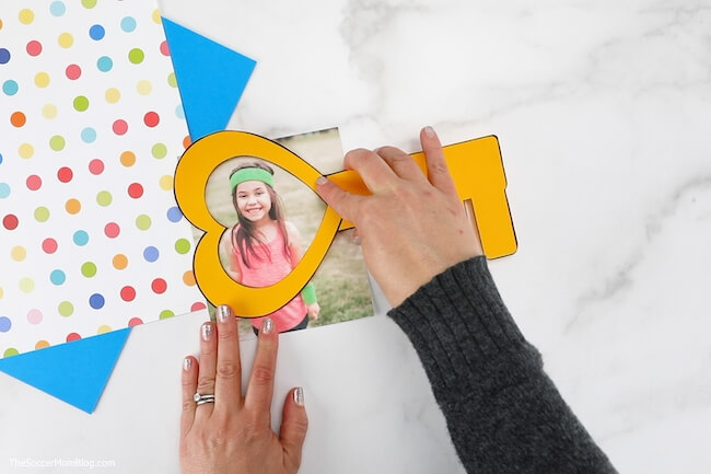 gluing child's photo to Key to My Heart card