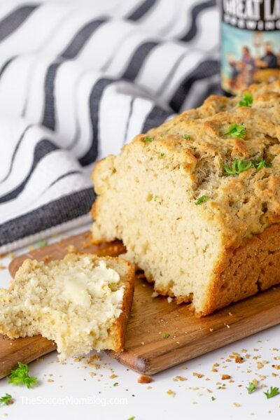 loaf of beer bread with a buttered slice