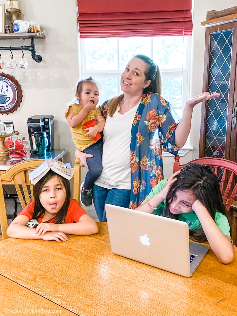 exasperated mom with kids homeschooling at kitchen table